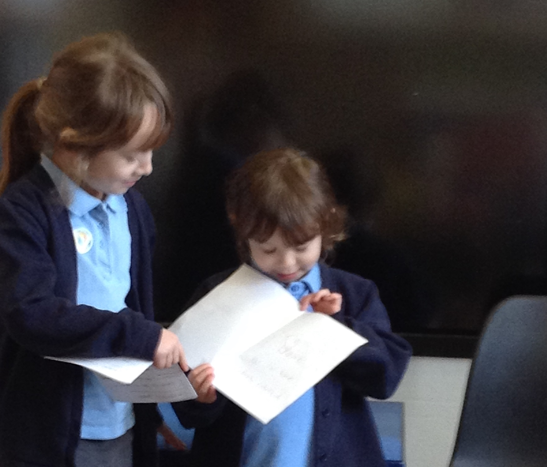 Children reading their school council speeches